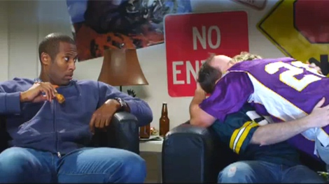 A screengrab taken off Mancrunch.com's video shows two men kissing after watching a football game.