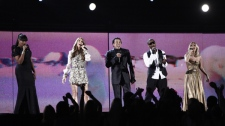 From left, Jennifer Hudson, Celine Dion, Smokey Robinson, Usher and Carrie Underwood perform during a tribute in honor of Michael Jackson at the Grammy Awards on Sunday, Jan. 31, 2010, in Los Angeles. (AP / Matt Sayles)