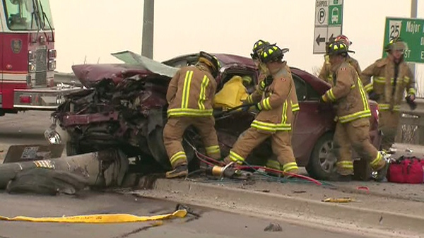 Vaughan Fire and Rescue Service work to free an injured driver from a vehicle involved in the crash, Tuesday, Feb. 2, 2010.