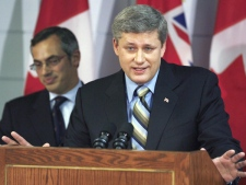 Prime Minister Stephen Harper announces his government's long-awaited anti-drug strategy as Health Minister Tony Clement looks on in Winnipeg, Thursday, Oct. 4, 2007. (THE CANADIAN PRESS / John Woods)