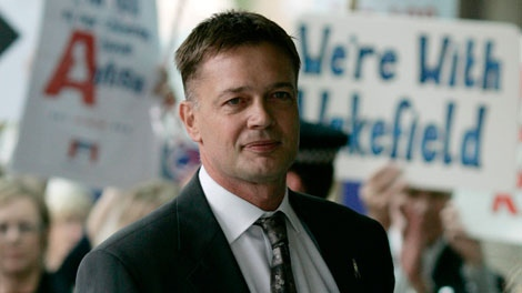 British doctor Andrew Wakefield arrives at the General Medical Council in London to face a disciplinary panel investigating allegations of serious professional misconduct on Monday, July 16, 2007. (AP / Sang Tan