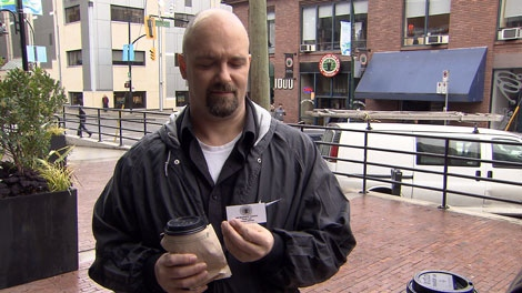 Customers at Bean around the World in Yaletown were being offered a customer card they were told would help them avoid higher prices during the Olympics. Feb. 3, 2010.
