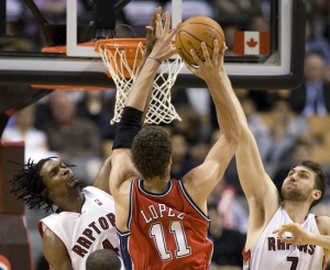 Toronto Raptors forward Chris Bosh and centre Andrea Bargnani block New  Jersey Nets centre Brook Lopez 3b5f39c4b