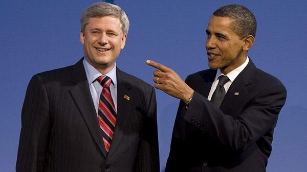 Prime Minister Stephen Harper is greeted by U.S. President Barack Obama as the G20 leaders arrive to a working dinner reception at the Phipps Conservatory on the opening day of the G20 Summit in Pittsburgh, Thursday, Sept. 24, 2009. (Sean Kilpatrick / THE CANADIAN PRESS)