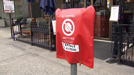 Red bags are placed over parking metres in Olympic-only traffic lanes. Feb. 4, 2010. (CTV)