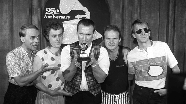 Members of 'Men at Work' pose with their Grammy for best new artist at the awards show in Los Angeles in this Feb. 22, 1983 photo. From left: Greg Hamm, Ron Strykert, Colin Hay, Jerry Speiser and John Rees. (AP Photo)
