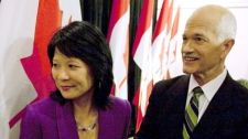 NDP Leader Jack Layton, right, holds hands with his wife Olivia Chow while leaving a press conference where Layton announced that he has been diagnosed with prostate cancer in Toronto, Friday, Feb. 5, 2010. (Darren Calabrese / THE CANADIAN PRESS)