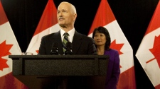 NDP Leader Jack Layton, accompanied by his wife Olivia Chow, announces that he has been diagnosed with prostate cancer at a press conference in Toronto, Friday, February 5, 2010. (Darren Calabrese / THE CANADIAN PRESS)