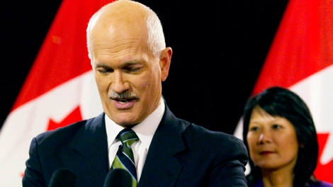 NDP Leader Jack Layton, left, announces that he has been diagnosed with prostate cancer while accompanied by his wife Olivia Chow at a press conference in Toronto, Friday, Feb. 5, 2010. (Darren Calabrese / THE CANADIAN PRESS)