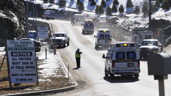 Fire and ambulance crews arrive at the scene of an explosion in Middletown, Conn., on Sunday, Feb. 7, 2010. (AP / Richard Messina, Hartford Courant)