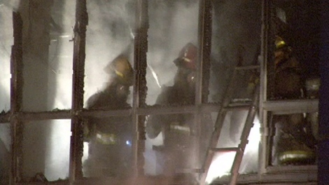 Firefighters inspect the gutted CTV Ottawa newsroom after a fire tore through the building on Sunday, Feb. 7, 2010.