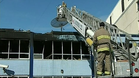 Fire officials attend the scene of a fire that gutted CTV Ottawa's newsroom over the weekend.