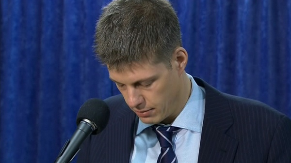 TTC chairman Adam Giambrone becomes emotional as he reads his statement during a press conference in Toronto, Wednesday, Feb. 10, 2010.