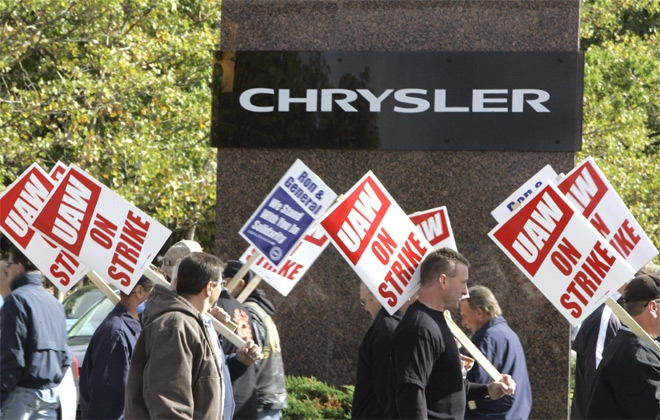 United Auto Workers walk the picket line outside Chrysler headquarters, background, in Auburn Hills, Mich., Wednesday, Oct. 10, 2007.  (AP  / Carlos Osorio)