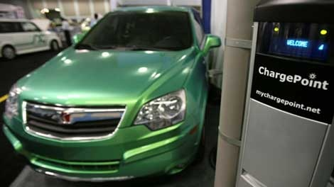 A Saturn Vue plug-in hybrid vehicle is shown with a Smartlet charging station at the Coulomb Technologies exhibit at the Plug-In 2008 conference on on Tuesday, July 22, 2008, in San Jose, Calif. (AP / Jeff Chiu)