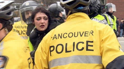 Vancouver police crowd control unit surrounds a protesters after anti-Olympic protesters rampage through downtown Vancouver, damaging businesses and vehicles on Saturday, Feb. 13, 2010 (CTV)
