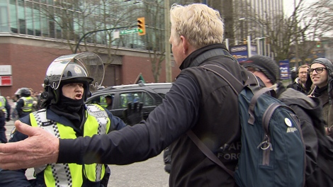 Anti-Olympic protesters rampage through downtown Vancouver, damaging businesses and vehicles on Saturday, Feb. 13, 2010 (CTV)