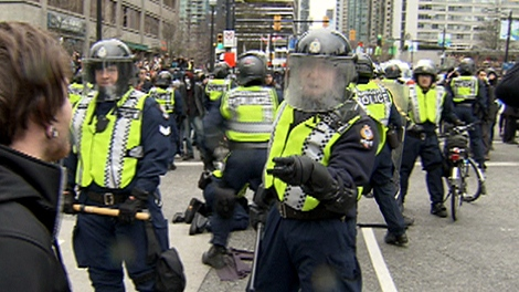 Police and protesters clash in downtown Vancouver, Saturday, Feb. 13, 2010.