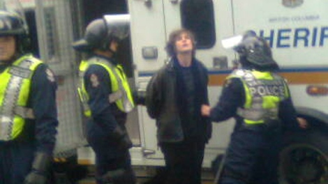Vancouver police take one alleged protester into custody after anti-Olympic protesters rampage through downtown Vancouver, damaging businesses and vehicles on Saturday, Feb. 13, 2010 (Chris Olsen/CTV)