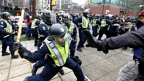 Protesters clash with police in downtown Vancouver during the second day of the 2010 Vancouver Olympic Winter Games in Vancouver. (Nathan Denette / THE CANADIAN PRESS)