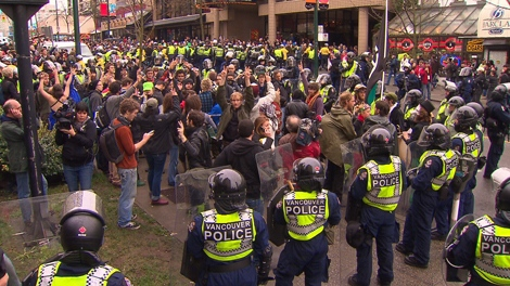 Vancouver police crowd control unit surrounds a group of protesters after anti-Olympic protesters rampage through downtown Vancouver, damaging businesses and vehicles on Saturday, Feb. 13, 2010 (CTV)