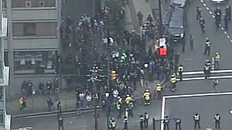 Olympic protesters clash with police in Vancouver, Saturday, Feb. 13, 2010.