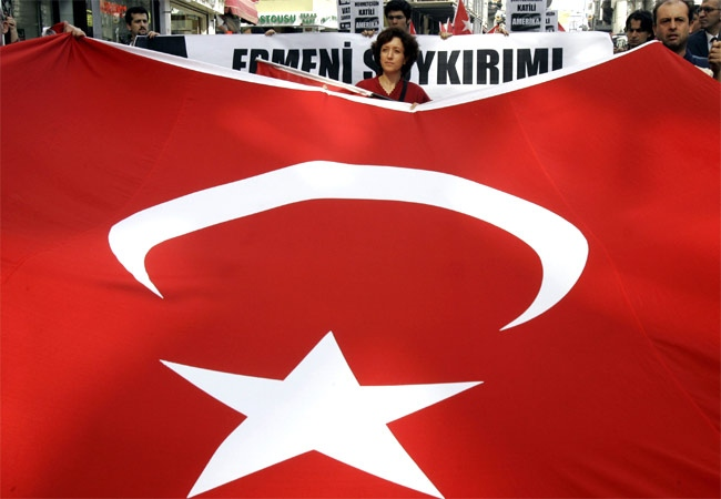 Members of the left-wing Workers' Party carry a huge Turkish flag during a protest against the U.S. in Istanbul, Turkey on Thursday, Oct. 11, 2007. (AP / Murad Sezer)