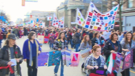 About 1,200 people in Vancouver followed drumming of female First Nations elders on a march honouring missing and murdered women on Feb. 14, 2010.