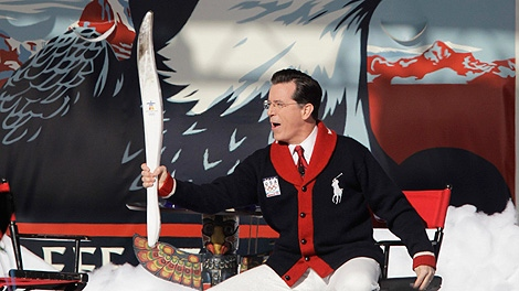 Comedian Stephen Colbert holds an Olympic torch during a taping of the Stephen Colbert Show at the Vancouver 2010 Olympics in Vancouver, British Columbia, Wednesday, Feb. 17, 2010. (AP Photo/Marcio Sanchez)
