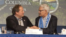 B.C. Premier Gordon Campbell and Montana Governor Brian Schweitzer shake hands after signing the Flathead River Basin agreement. Wednesday, Feb. 18, 2010. (BCMC)