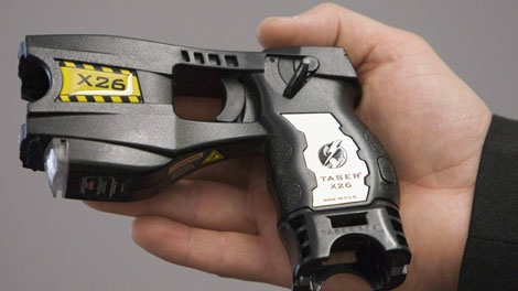 A police issued taser is displayed at the Victoria police station in Victoria, B.C. May 7, 2008. (THE CANADIAN PRESS/Jonathan Hayward)
