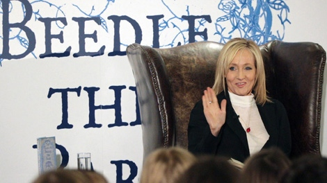 Author JK Rowling reads to about 200 schoolchildren at a tea party in the Parliament Hall Edinburgh. Dec, 4, 2008. (AP Photo/ David Cheskin, Pool)
