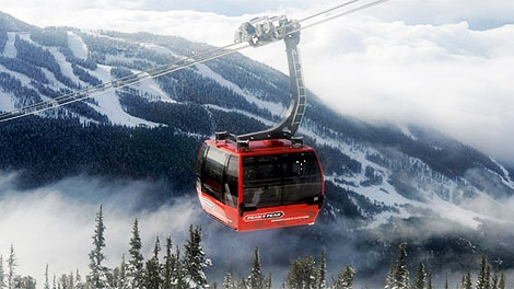 A Peak 2 Peak gondola cabin makes it's journey across the distance between Whistler and Blackcomb Mountains in Whistler, British Columbia, Tuesday, Feb. 16, 2010. (AP Photo/Gero Breloer)