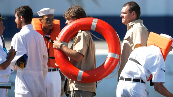 A student from Canada�s West Island College holds a life preserver upon his arrival at the Mocangue naval base in Rio de Janeiro, Saturday, Feb. 20, 2010. (AP / Felipe Dana)