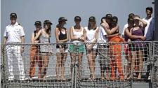Unidentified students of Canada's West Island College, arrive at the Mocangue naval base in Rio de Janeiro, Saturday, Feb. 20, 2010. (AP / Felipe Dana)