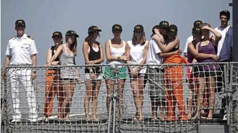 Unidentified students of Canada's West Island College, arrive at the Mocangue naval base in Rio de Janeiro, Saturday, Feb. 20, 2010. (AP / Felipe Dana)