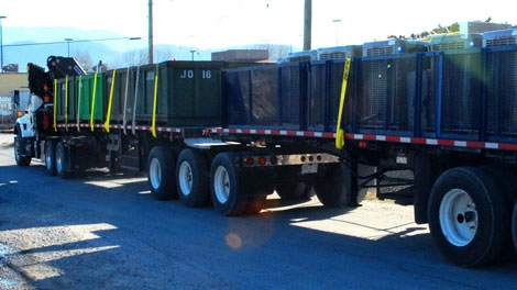 Police in Abbotsford, B.C., needed two large trailers to haul away marijuana and production equipment after executing a search warrant on a grow operation on Feb. 18, 2010. Two people are charged. (Handout photo)