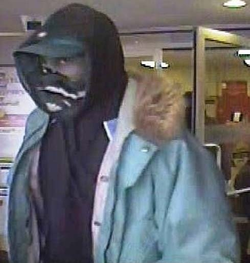 Toronto Police released this undated security camera image of someone they identify as an armed robbery suspect.