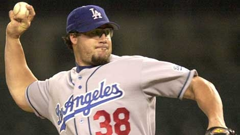 Los Angeles Dodgers closer Eric Gagne throws against the Detroit Tigers in the 12th inning in Detroit, Tuesday, June 10, 2003. Gagne got his 22nd save in 22 opportunities in the Dodgers' 3-1 win. (AP Photo/Paul Sancya)
