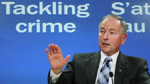 Justice Minister Rob Nicholson holds a news conference in Ottawa to discuss Bill C-25, on Tuesday, Feb. 23, 2010. (Fred Chartrand / THE CANADIAN PRESS)