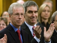 Liberal leader Stephane Dion is applauded by Deputy Leader Michael Ignatieff and other caucus members during his response to the Speech from the Throne in Ottawa on Wednesday, Oct. 17, 2007. (CP / Tom Hanson)