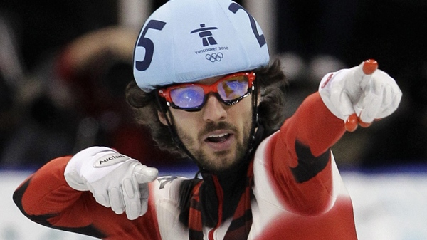 Charles Hamelin reacts after winning the gold medal in the men's 500m short track skating competition at the 2010 Olympics in Vancouver, B.C., on Friday, Feb. 26, 2010. (AP / Amy Sancetta)
