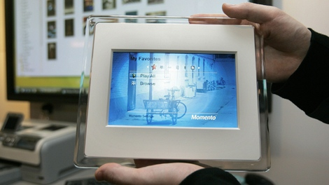 Momento's digital picture frame is shown at the Consumer Electronics Show in Las Vegas on Thursday, Jan. 11, 2007. The device supports Microsoft's Windows Vista SideShow feature. (AP Photo/Jae C. Hong)