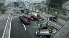 Vehicles that were driving along a highway that collapsed during the earthquake near Santiago are seen overturned on the asphalt Saturday, Feb. 27, 2010. (AP / David Lillo)