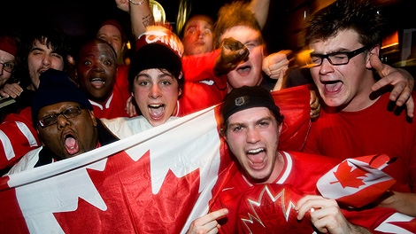 Team Canada hockey fans celebrate at the Peel Pub in Montreal, Sunday, Feb. 28, 2010, after Canada defeated the United States 3-2 in the Vancouver 2010 winter olympic gold medal hockey game. (CP/Graham Hughes)