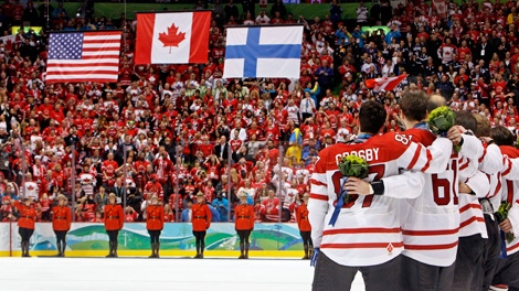 Team Canada celebrates National anthem at the Vancouver Olympics