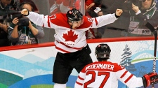 Canada's Sidney Crosby celebrates his game winning goal with Scott Niedermayer and Drew Doughty during overtime period men's ice hockey gold medal final at the 2010 Winter Olympic Games in Vancouver, Sunday, Feb. 28, 2010. (CP/Paul Chiasson)