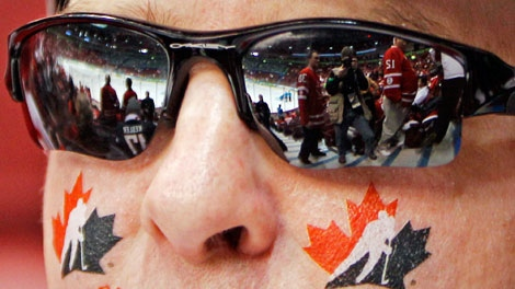 Fans arrive for before the men's gold medal ice hockey game between Canada and USA at the Vancouver 2010 Olympics in Vancouver, British Columbia, Sunday, Feb. 28, 2010. (AP Photo/Gene J. Puskar)