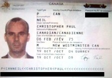 Christopher Paul Neil's Canadian passport is seen in this image released by Interpol.
