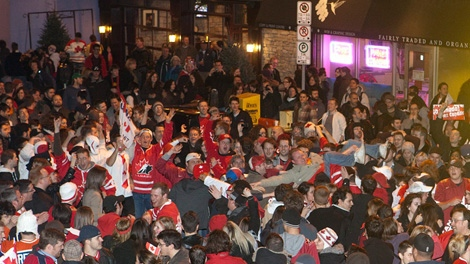 A crowd of celebratory Team Canada hockey fans blocks traffic on Elgin Street in Ottawa following Team Canada's overtime win to take gold in men's hockey at the 2010 Vancouver winter Olympics on Sunday, Feb. 28, 2010. THE CANADIAN PRESS/Pawel Dwulit